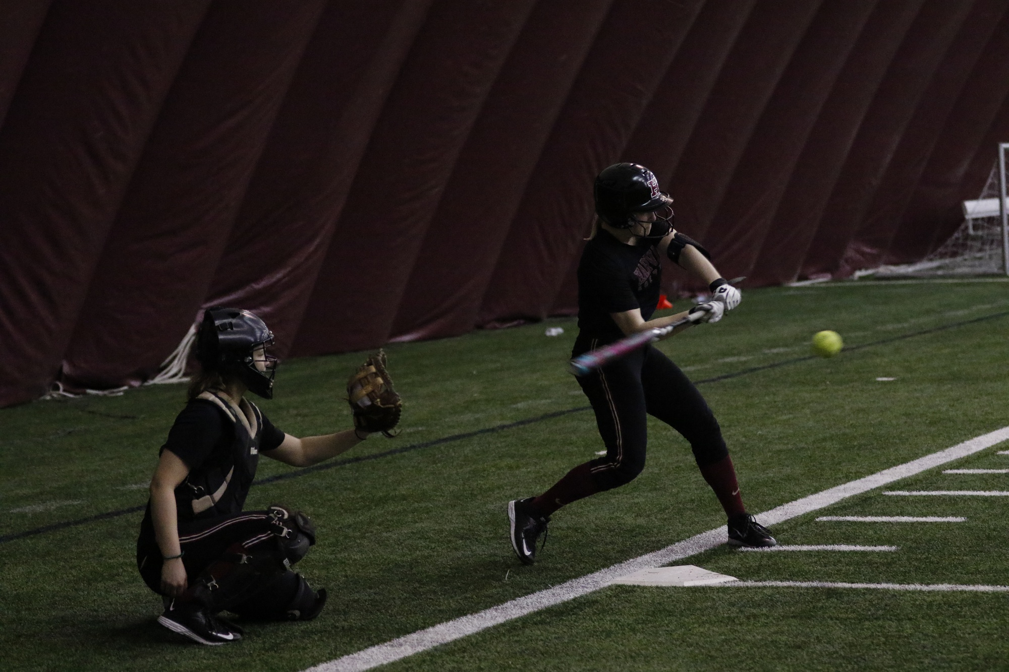 For many weeks, the softball team has practiced in Harvard stadium beneath an inflatable dome.