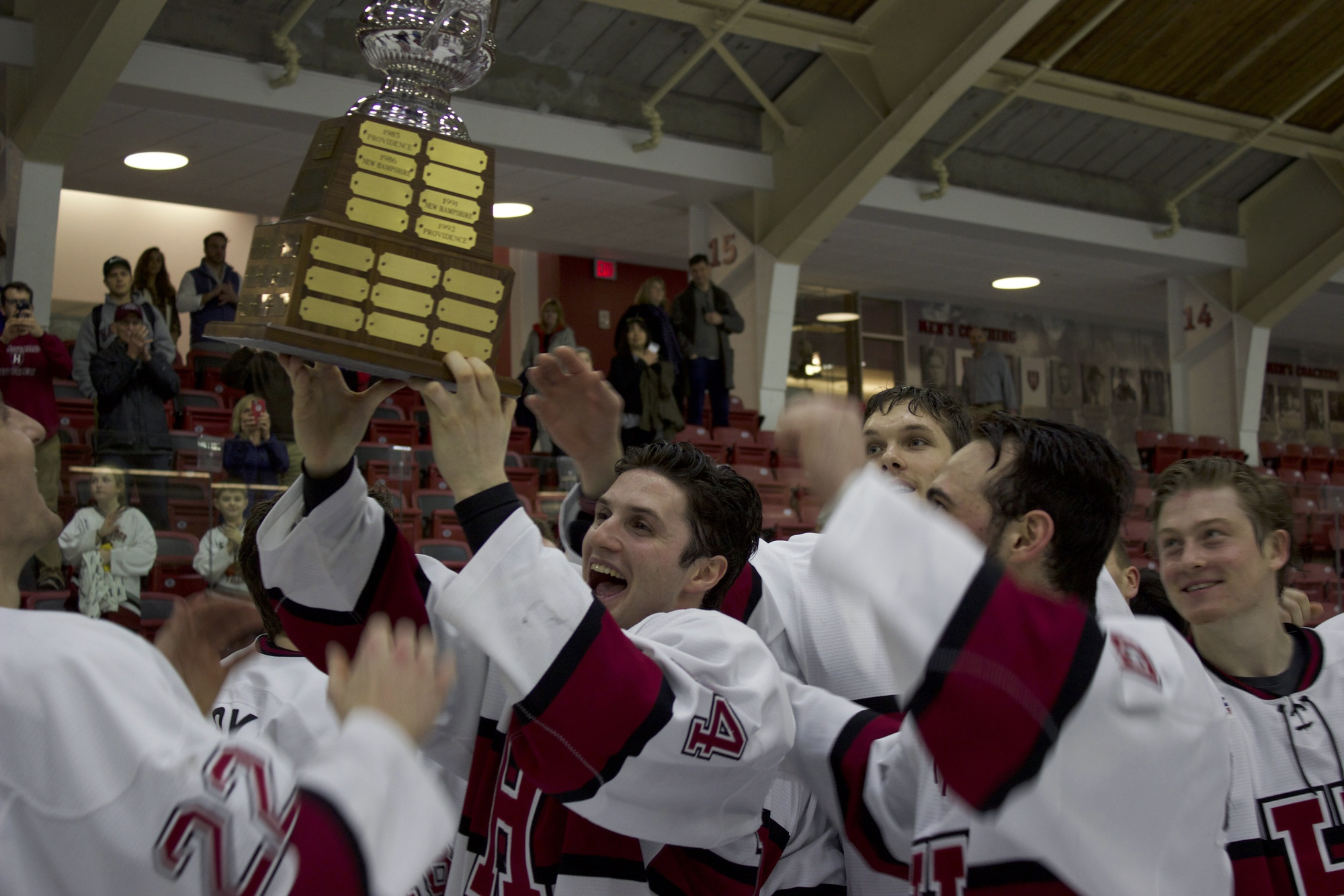 Co-captain Alexander Kerfoot celebrates with a stand-in replica for the Cleary Cup, given to the ECAC's regular season champion.
