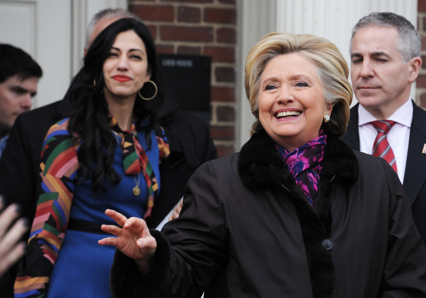 Hillary Clinton waves at a crowd of students gathered outside Loeb House on Friday afternoon. The former Secretary of State visited Harvard's campus to be interviewed as part of a joint Kennedy School, Law School, and Business School project.