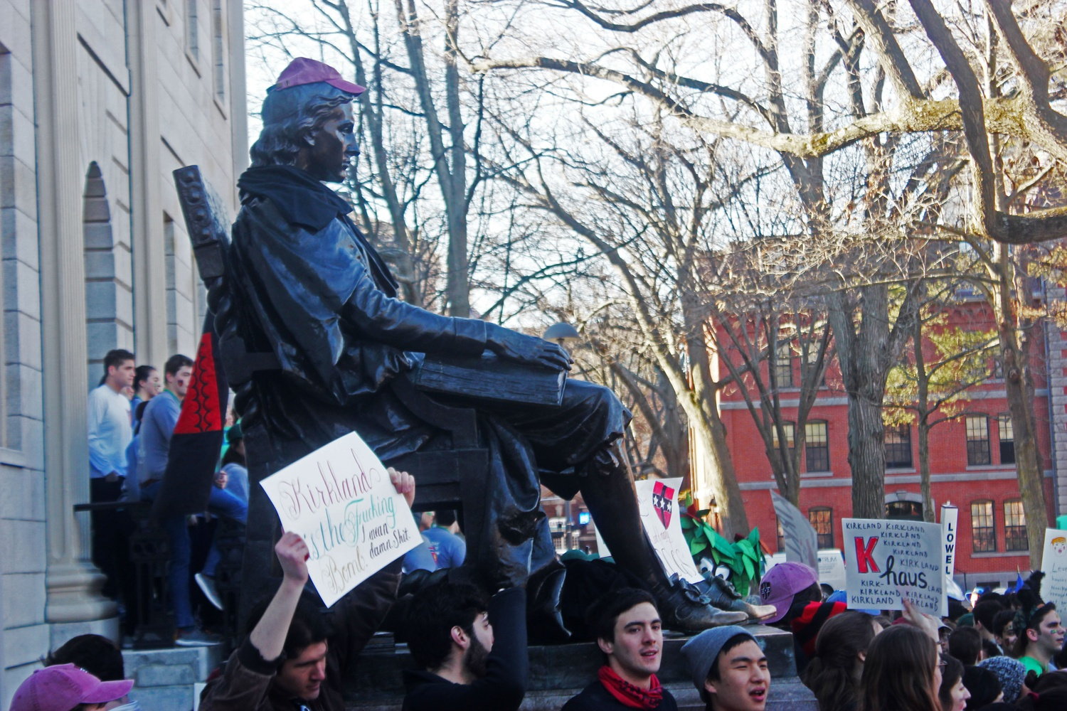 Members of Kirkland House stand guard around the John Harvard Statue, which they claimed with a Kirkland baseball cap.