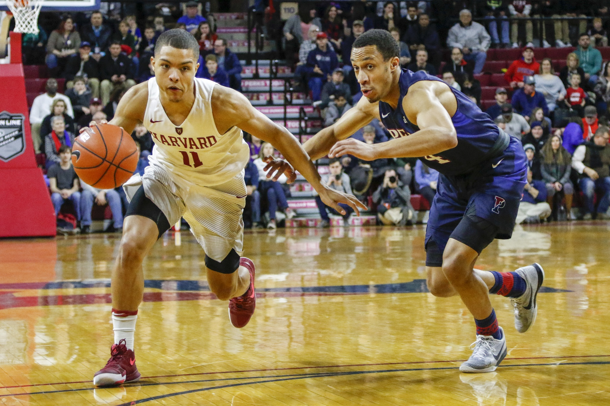 Freshman guard Bryce Aiken drives in Harvard's Mar. 4 loss against Penn. Aiken will have an increased load next year due to the departure of senior guard Siyani Chambers as the Crimson hope for the best.