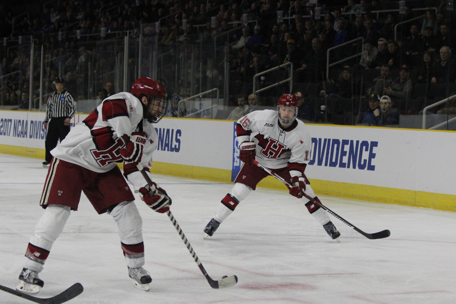 Approaching the Air Force goal, senior forward Alex Kerfoot looks to pass to teammate Ryan Donato. Kerfoot would finish the night with two assists, Donato with a goal.