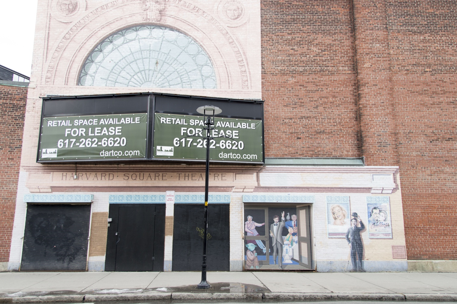 The Harvard Square Theater on Church Street advertises leasing. The brick building remains vacant years after its closing, prompting the Cambridge City Council to look into the owner's plans for its redevelopment.