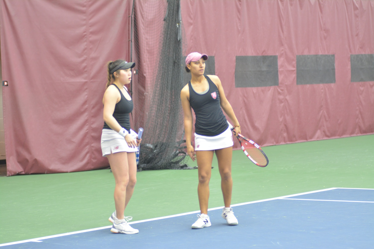 Captain June Lee and sophomore Erica Oosterhout, pictured here against Bryant, fell in doubles action but both picked up singles win in the Crimson's 4-3 win over Dartmouth on Sunday.
