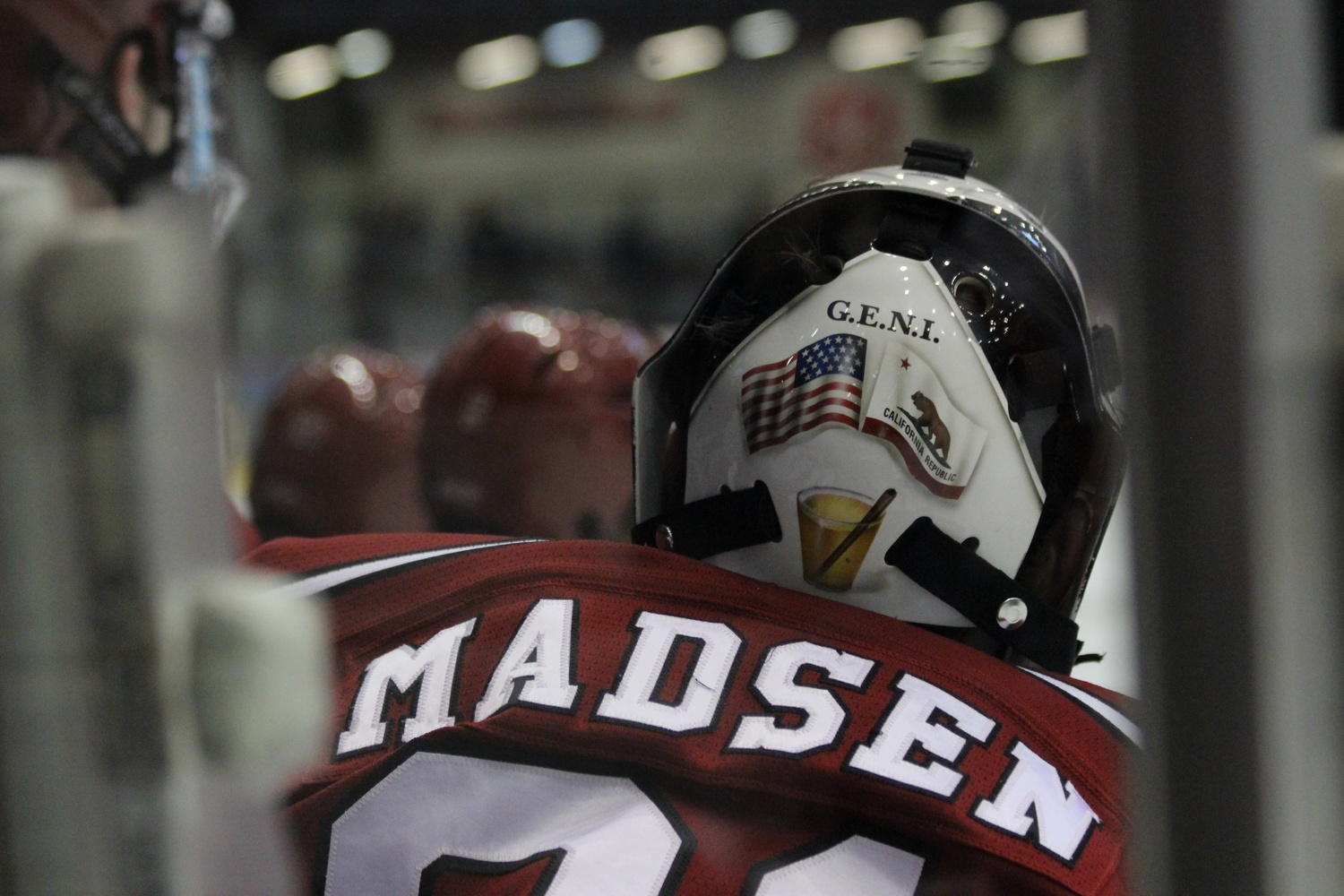 In addition to the G.E.N.I. acronym, the back of Merrick Madsen's helmet features the flag for his home state of California.