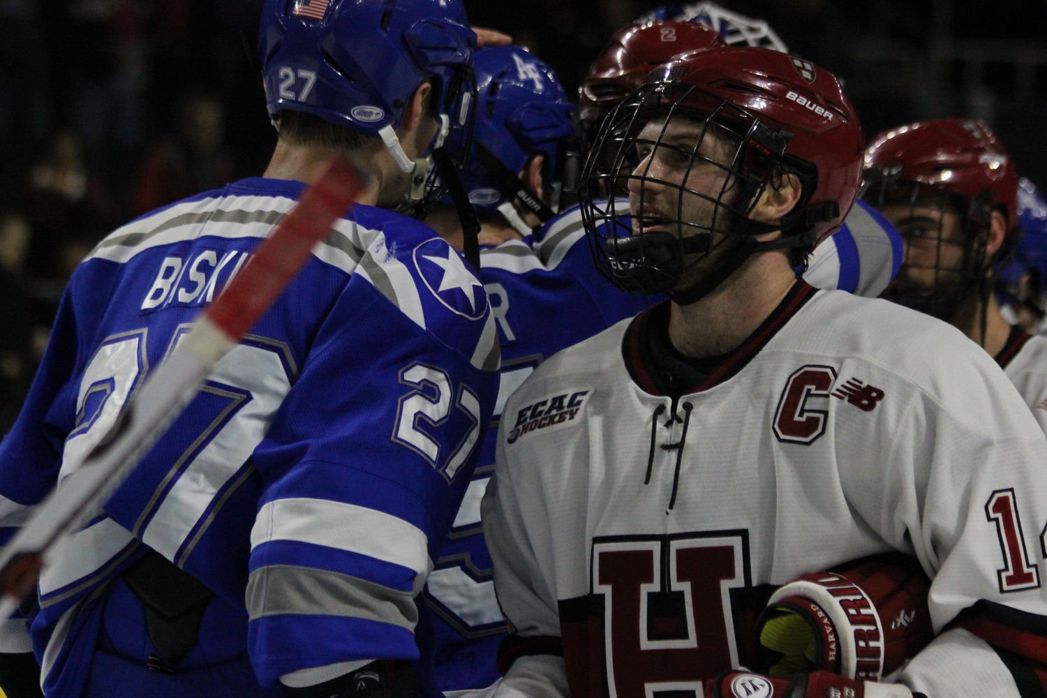 Alexander Kerfoot makes his way through the handshake line after Harvard's 3-2 win over Air Force in the East Regional.