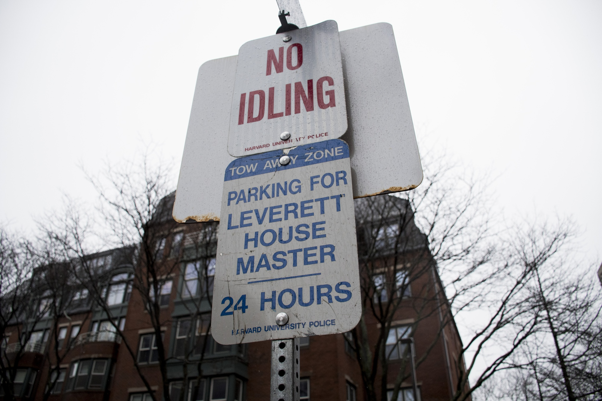 A designated parking sign outside Leverett House's McKinlock Hall reads 'House Masters' more than a year after the position was renamed 'Faculty Deans'.