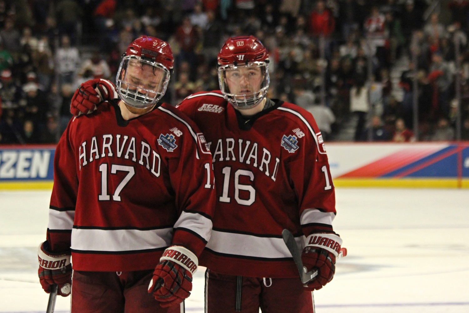 Harvard's Sean Malone and Ryan Donato tearfully exit the ice following the Crimson's 2-1 loss to Minnesota-Duluth in the Frozen Four Tournament.
