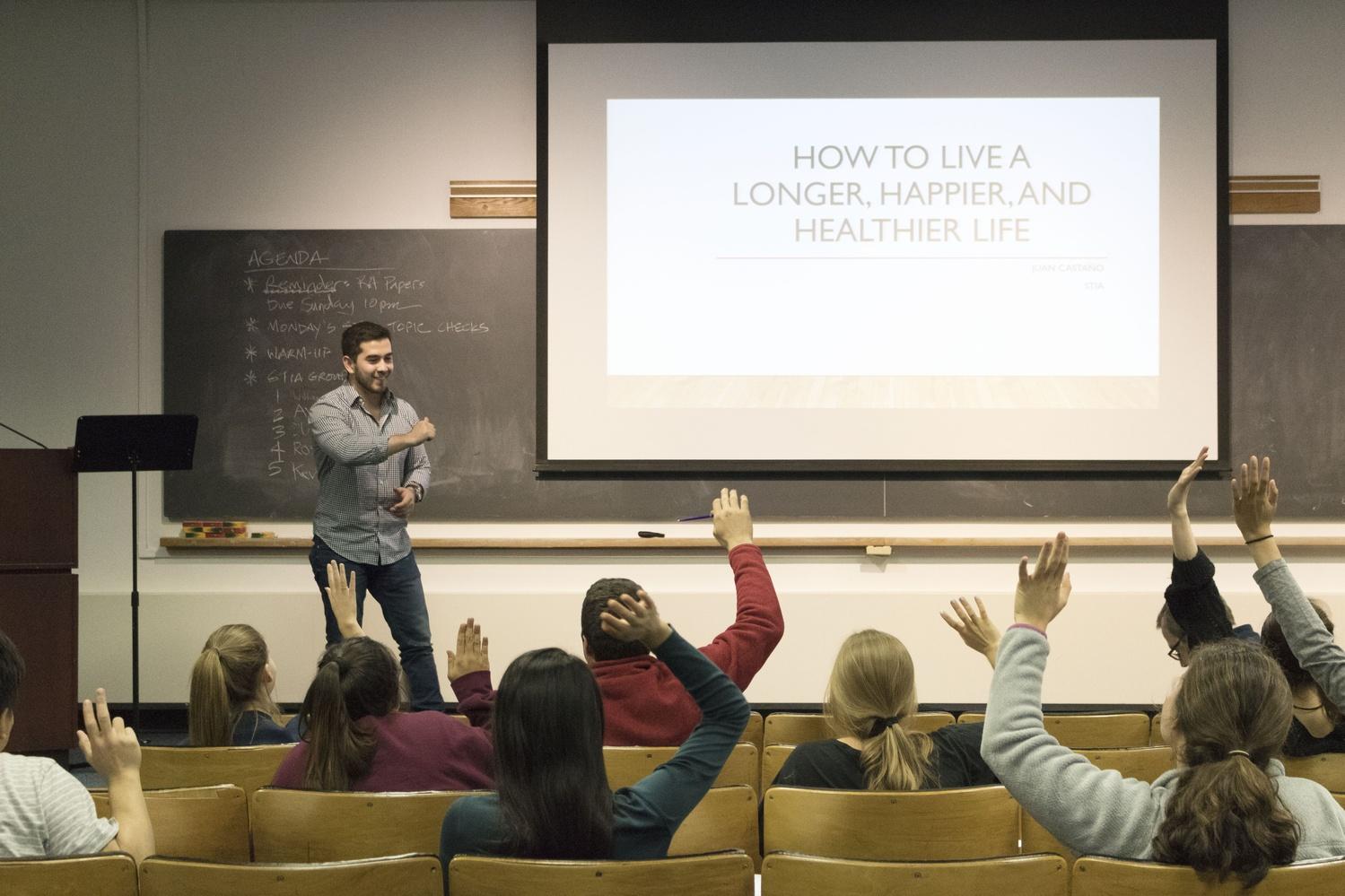 Juan P. Castaño '17 presents a speech on happiness as part of Expos 40, a public speaking class.
