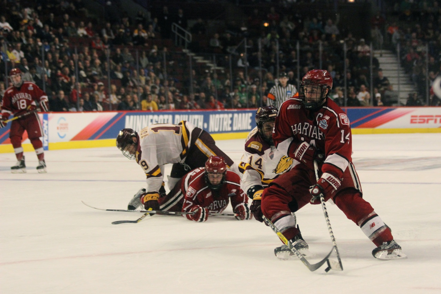 Senior forward Alexander Kerfoot escapes the Minnesota-Duluth defense.