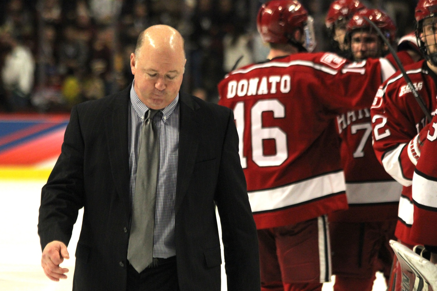 Coach Ted Donato '91 leaves the ice following Thursday evening's 2-1 loss to Minnesota-Duluth in Harvard's first Frozen Four appearance since 1994.