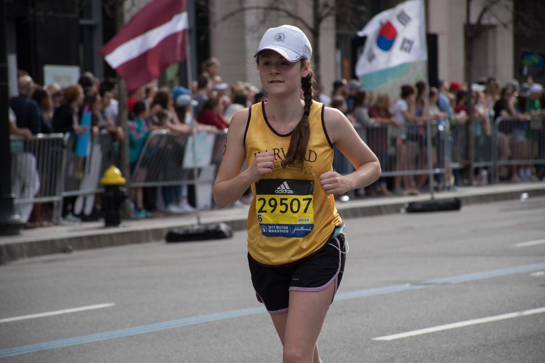 Naomi G. Asimow '18 runs in aid of PBHA in the Boston Marathon on Monday.