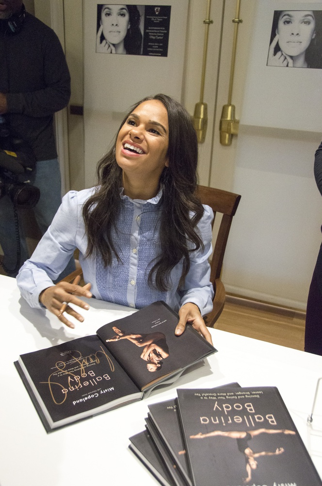 Misty Copeland, the first African American principal dancer at American Ballet Theatre, signs a copy of her book Monday afternoon.
