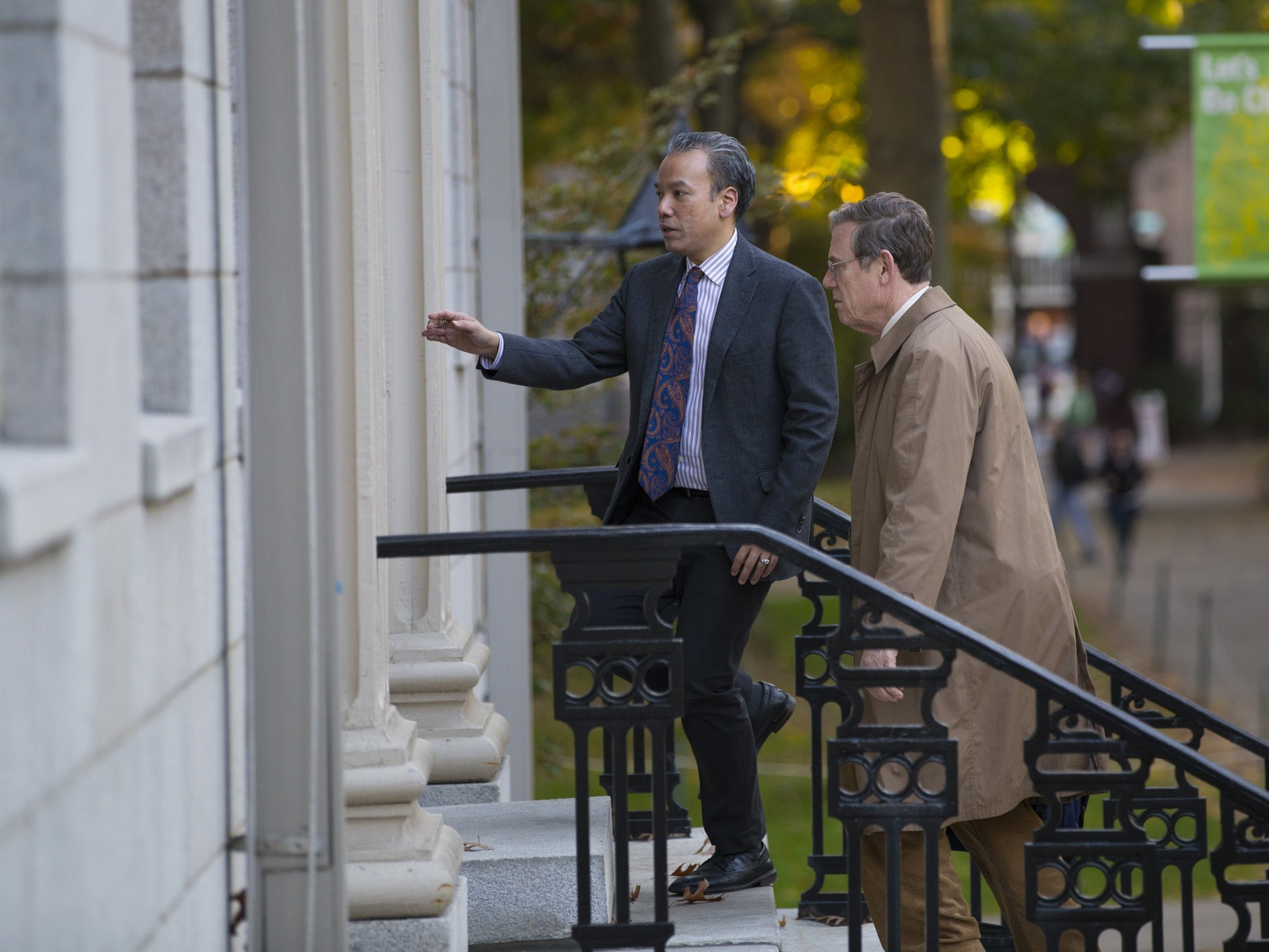 Robert A. Lue, left, and Vice Provost for Advances in Learning Peter K. Bol enter University Hall before a faculty meeting in November 2015.