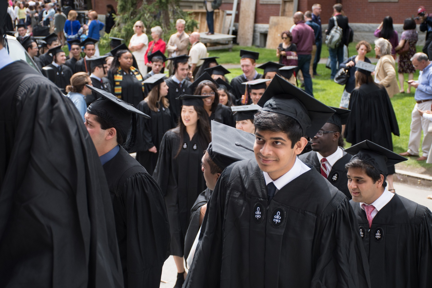Parijat Lal '17 processes up the steps of Memorial Church for the Baccalaureate Service on Tuesday afternoon.
