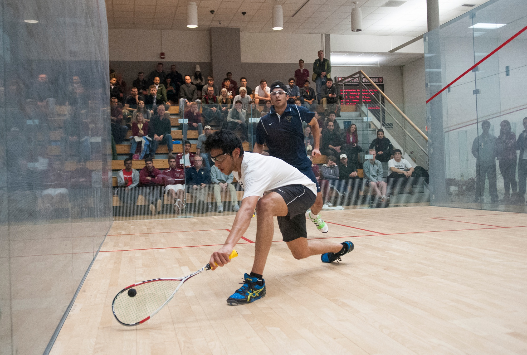 Madhav Dhingra, now a junior, lunges for a shot in a 2015 match against Trinity.