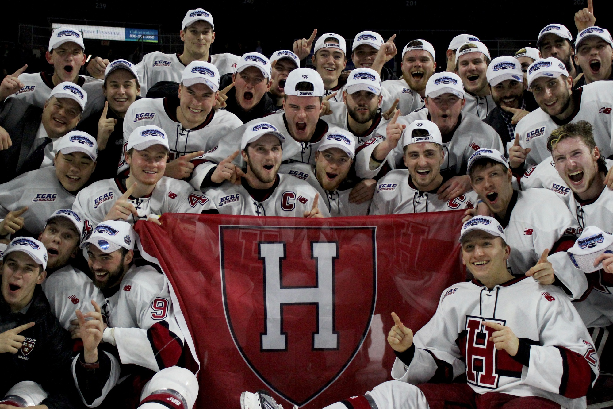 The men's hockey team celebrates after clinching a spot in the Frozen Four with a 3-2 win over Air Force.