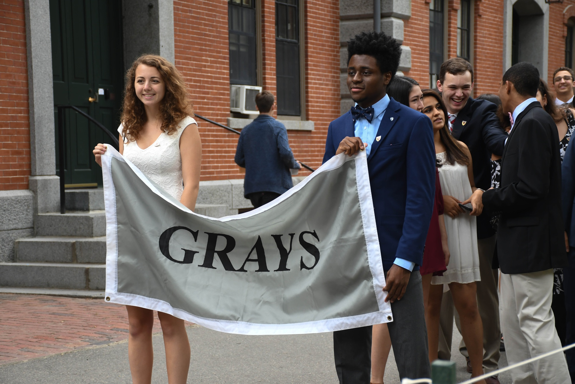 Amanda R. Powers '21 and Eliel T. E. Ig-Izevbekhai '21, residents of Grays Middle entryway, hold up the banner for their dorm during the procession to Tercentenary Theater for Convocation on Tuesday.