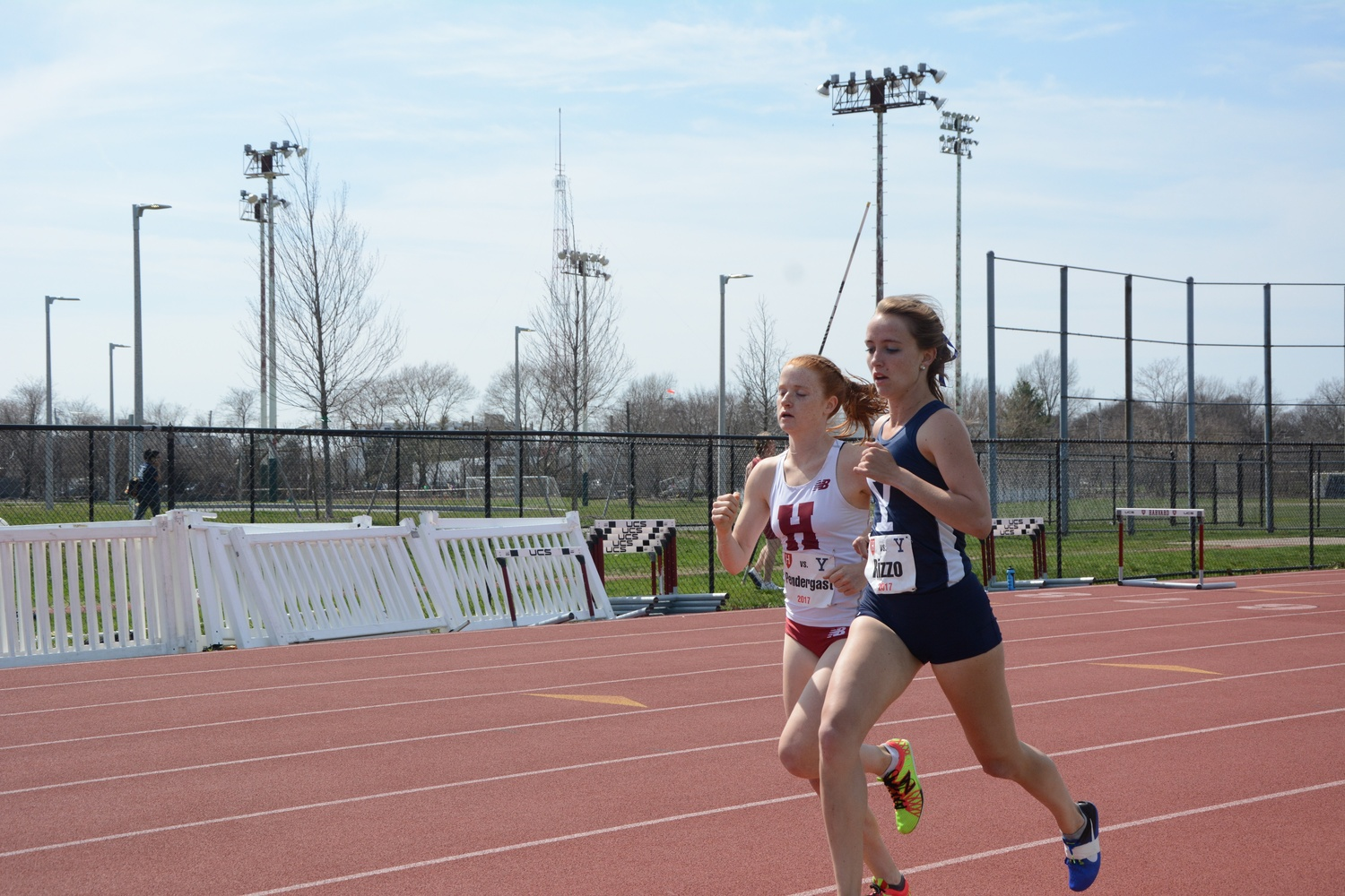 Sophomore Judy Pendergast keeps pace with a Yale opponent at a home meet this spring. Over the summer, the distance runner was one of five Crimson athletes to compete at the NCAA Outdoor Championships.