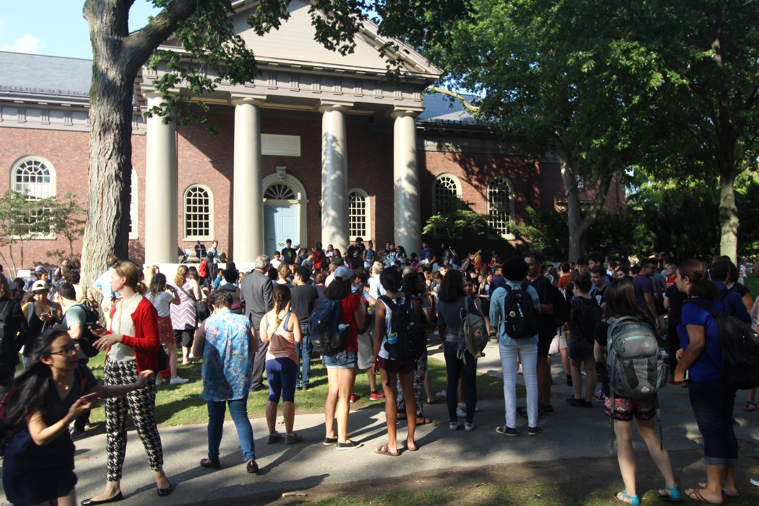 A crowd looks on as students speak at a rally for immigrant rights in September in front of Memorial Church.