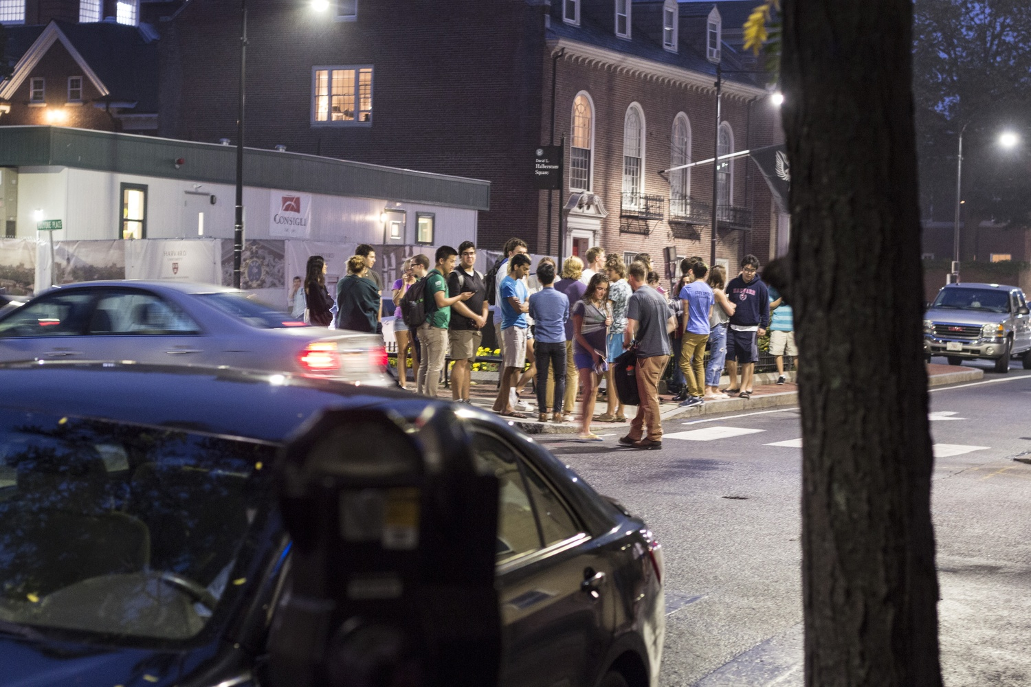 Students gather outside after fire alarms went off in Claverly Hall of Adams House Wednesday night.
