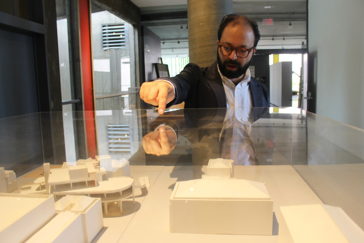 Dan Byers points out locations on a scaled model of the Carpenter Center constructed in the 1960's. Byers has recently become Director of the Carpenter Center for the Visual Arts, coming to Harvard from The Institute of Contemporary Arts/Boston.