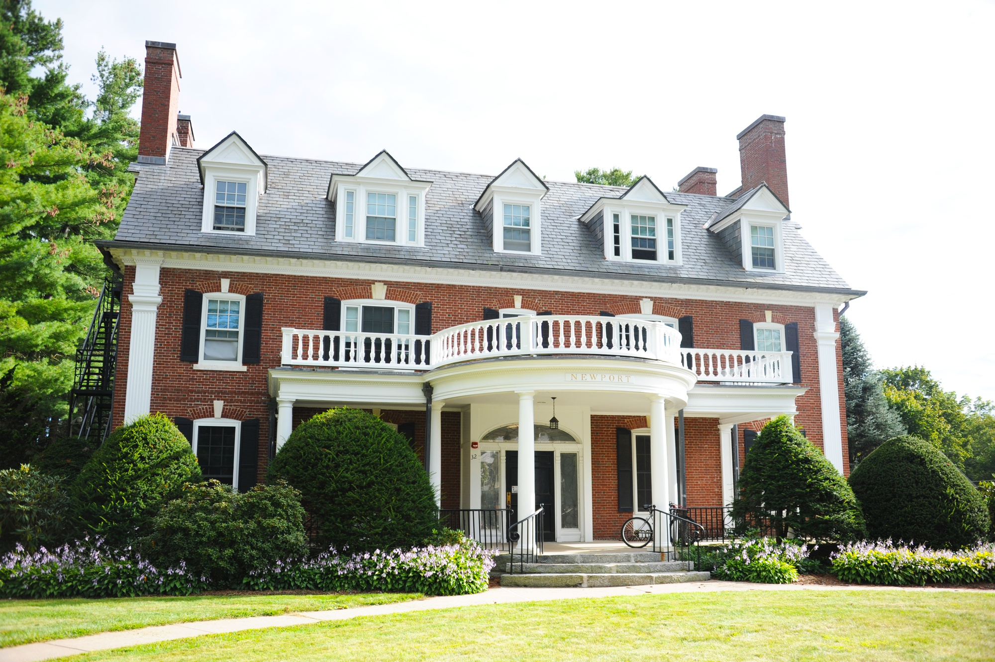 Newport House, formerly known as Phi Delta Sigma. After Amherst College banned in fraternities in 1984, the college purchased most of the former fraternity houses and converted them to residential houses.