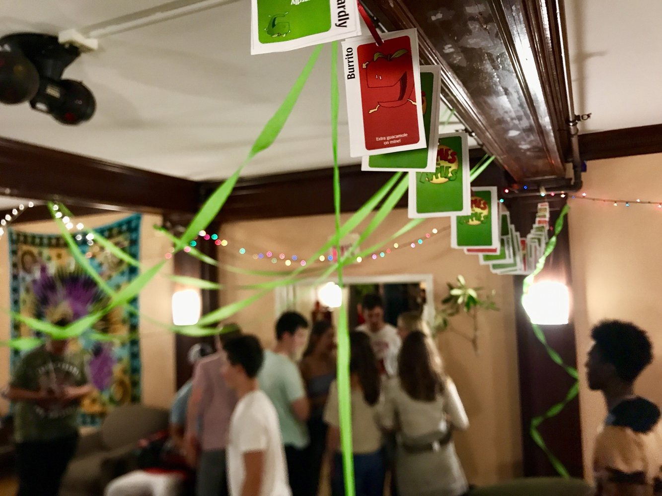 Students talk and dance during an apple-themed party at Bowdoin's Reed House—formerly Chi Psi.