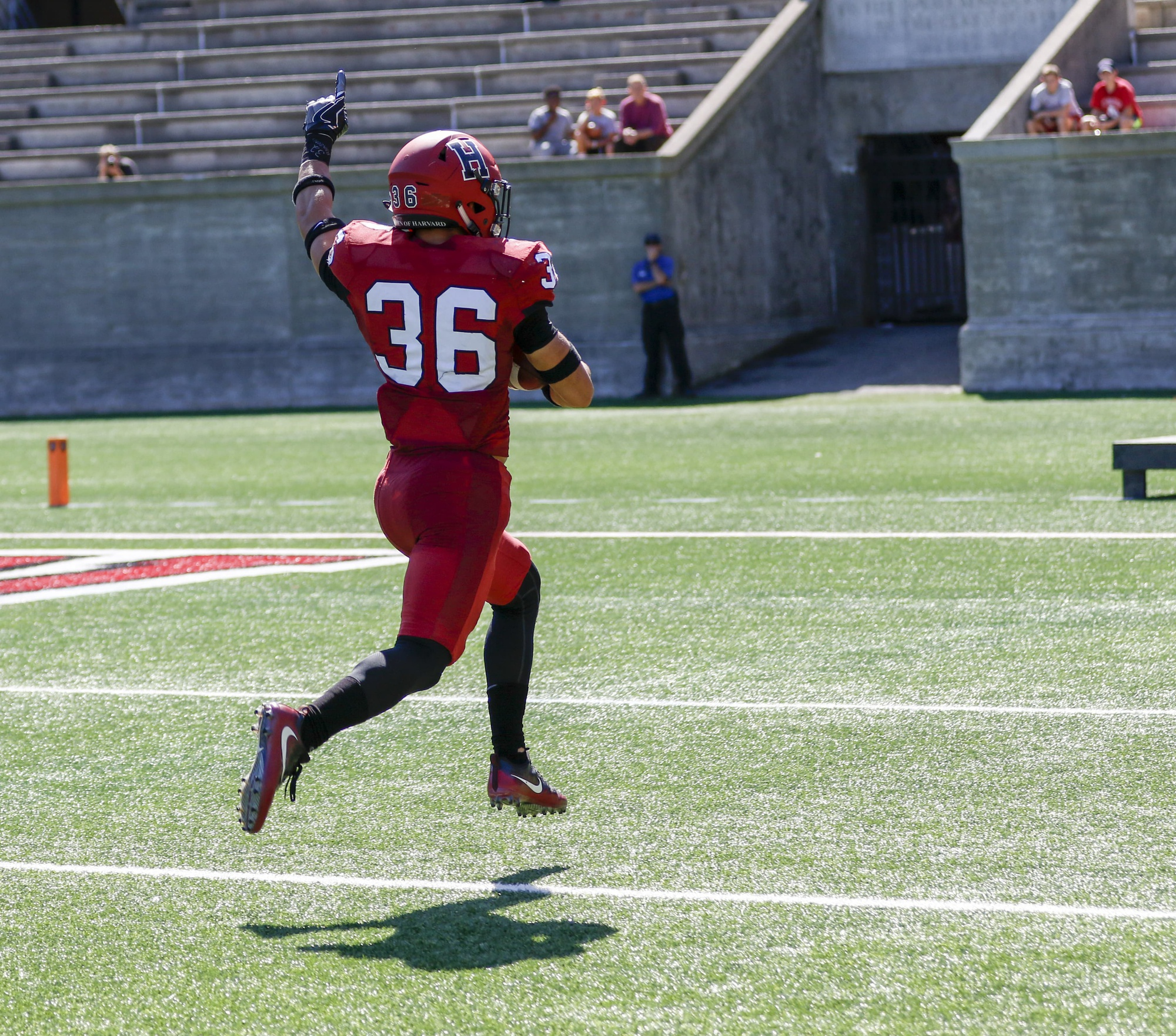 Safety Tanner Lee skips into the end zone after hauling in a first-half interception. The senior spearheaded a defense that collected three picks.
