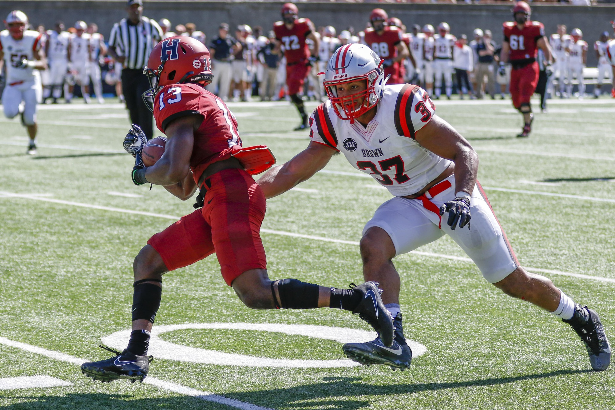 Junior wide receiver Adam Scott aims to evade a tackle. He led Harvard with 79 receiving yards on five catches.