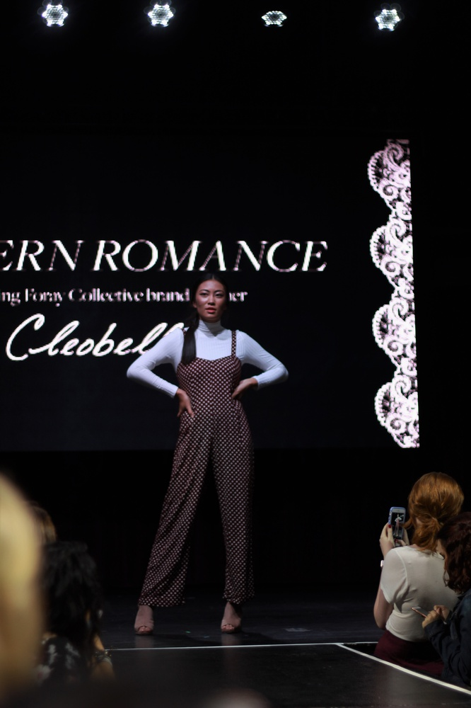 A model walks the runway for the HerCampus College Fashion Week show at Royale Boston on Saturday evening.