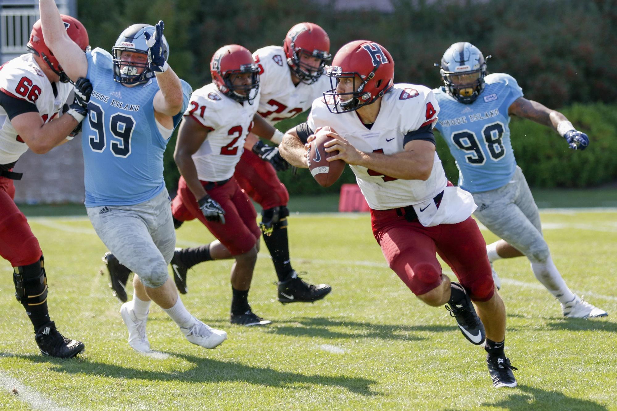 Senior quarterback Joe Viviano scrambles away from pressure in the season opener at Rhode Island.