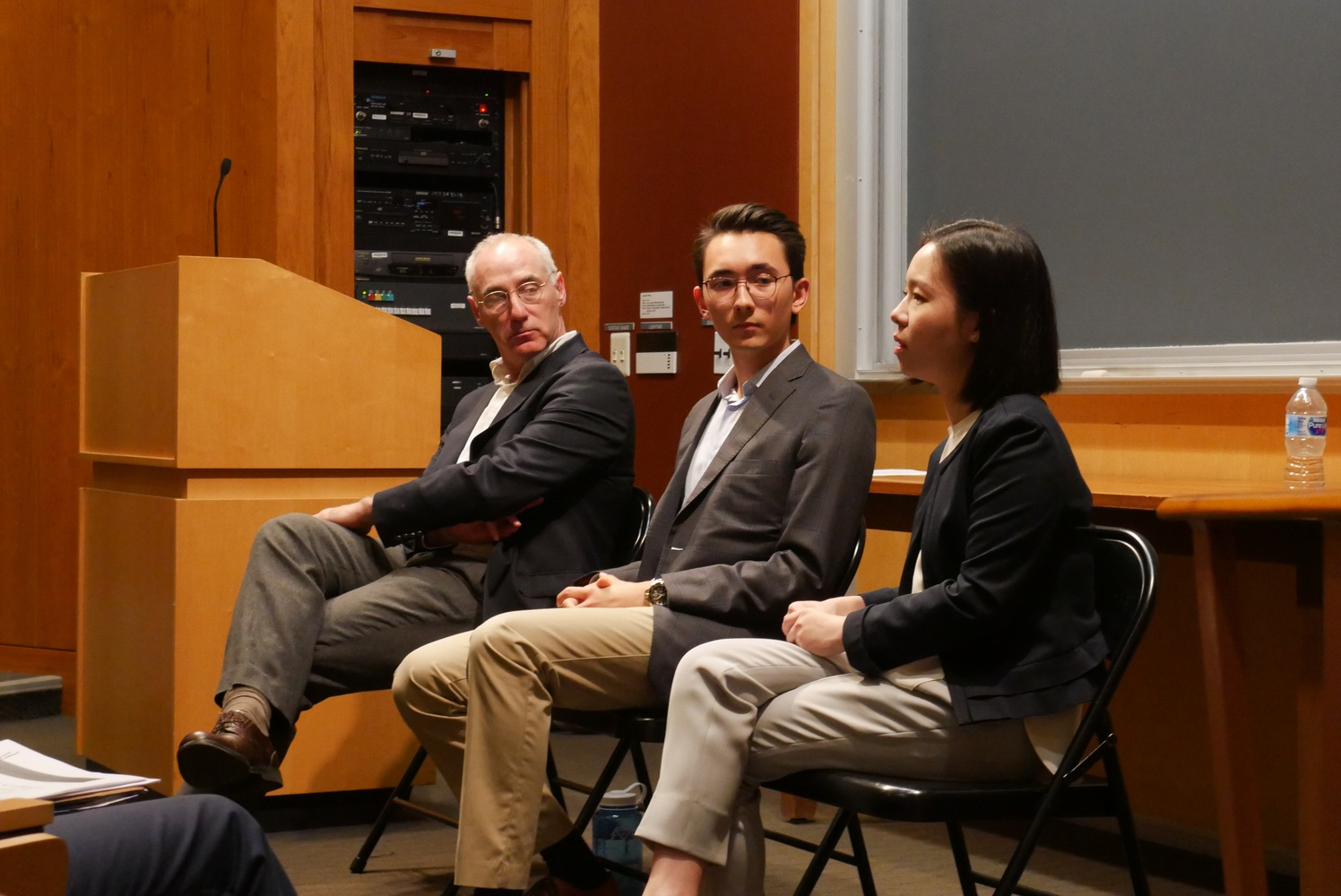 Brett Flehinger, the Secretary of the Honor Council, Jack W. Jue '18, and Margery W. Tong '17 speak at a town-hall meeting on the Honor Code.