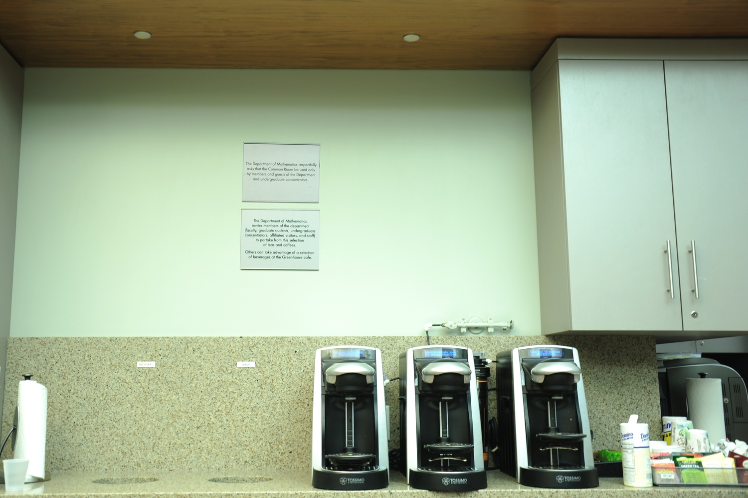 Two plaques hang on the wall of the math common room. Administrators installed the plaques after undergraduates complained department staffers disproportionately removed women from the lounge.