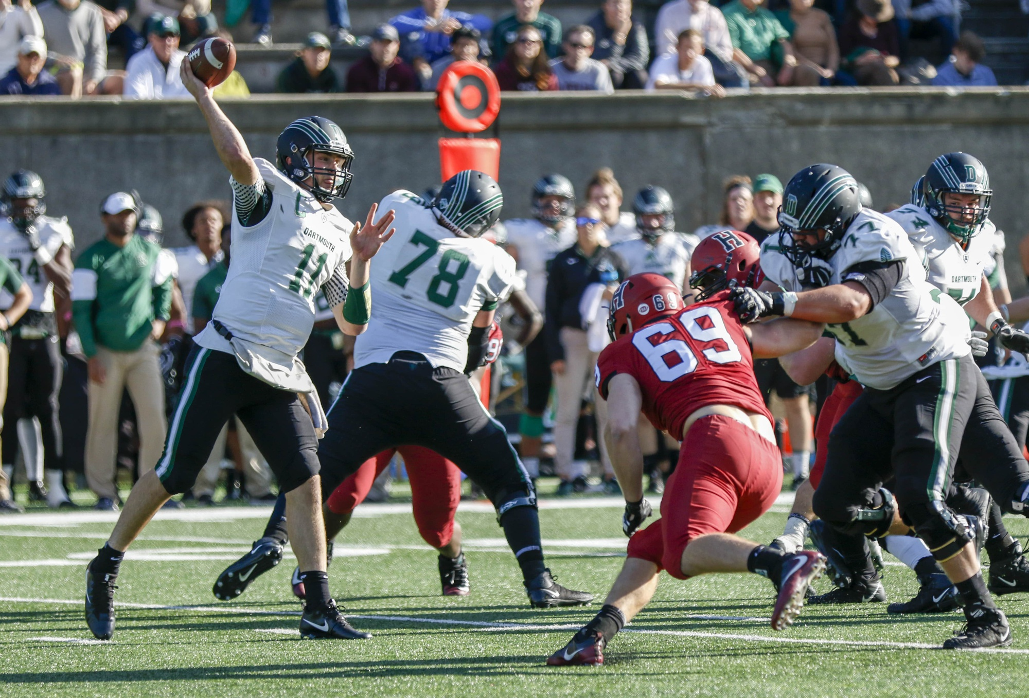 Dartmouth quarterback Jack Heneghan rears back for a throw against the Crimson.