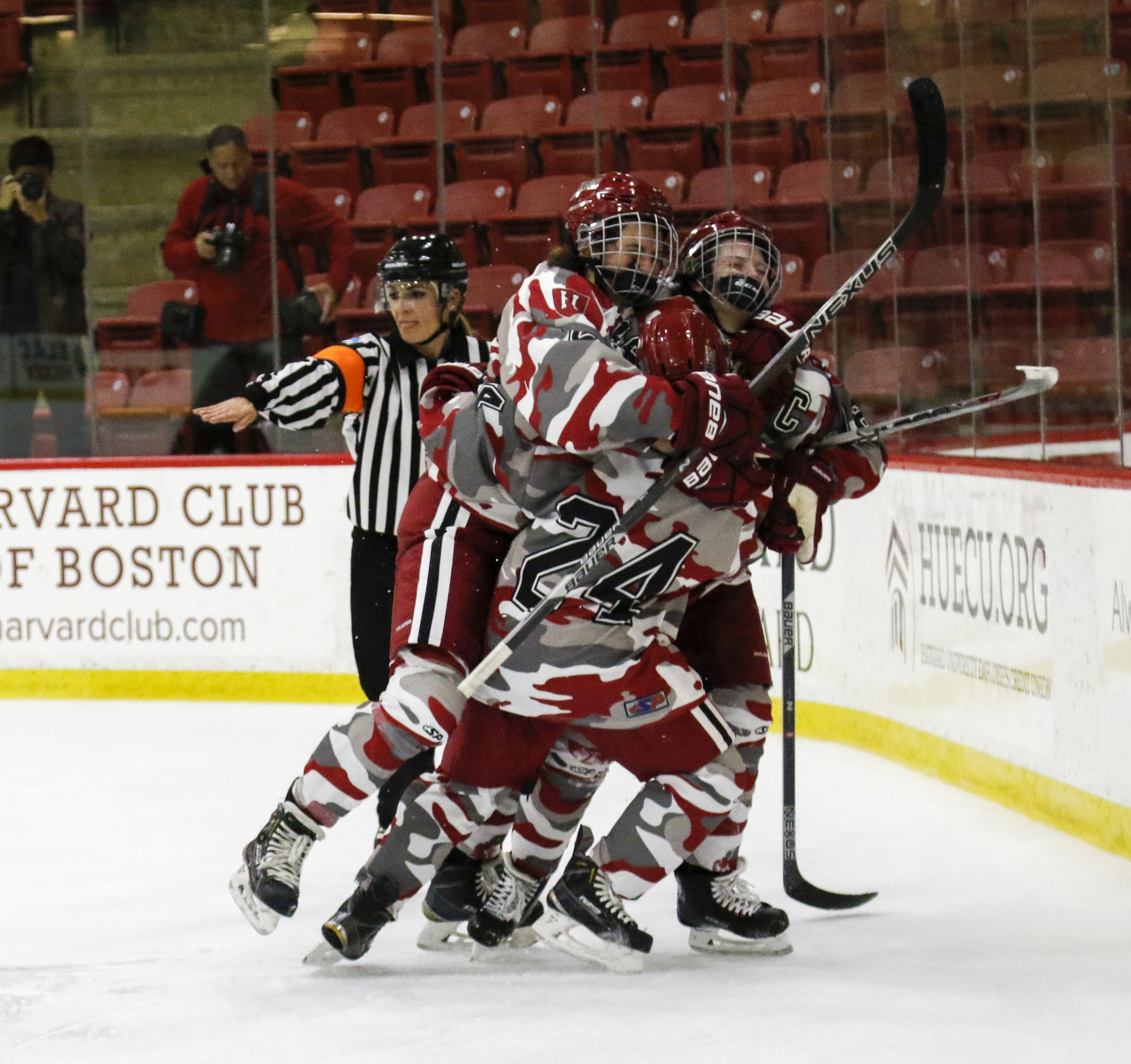 Crimson players celebrate after a goal in an early win against Dartmouth.