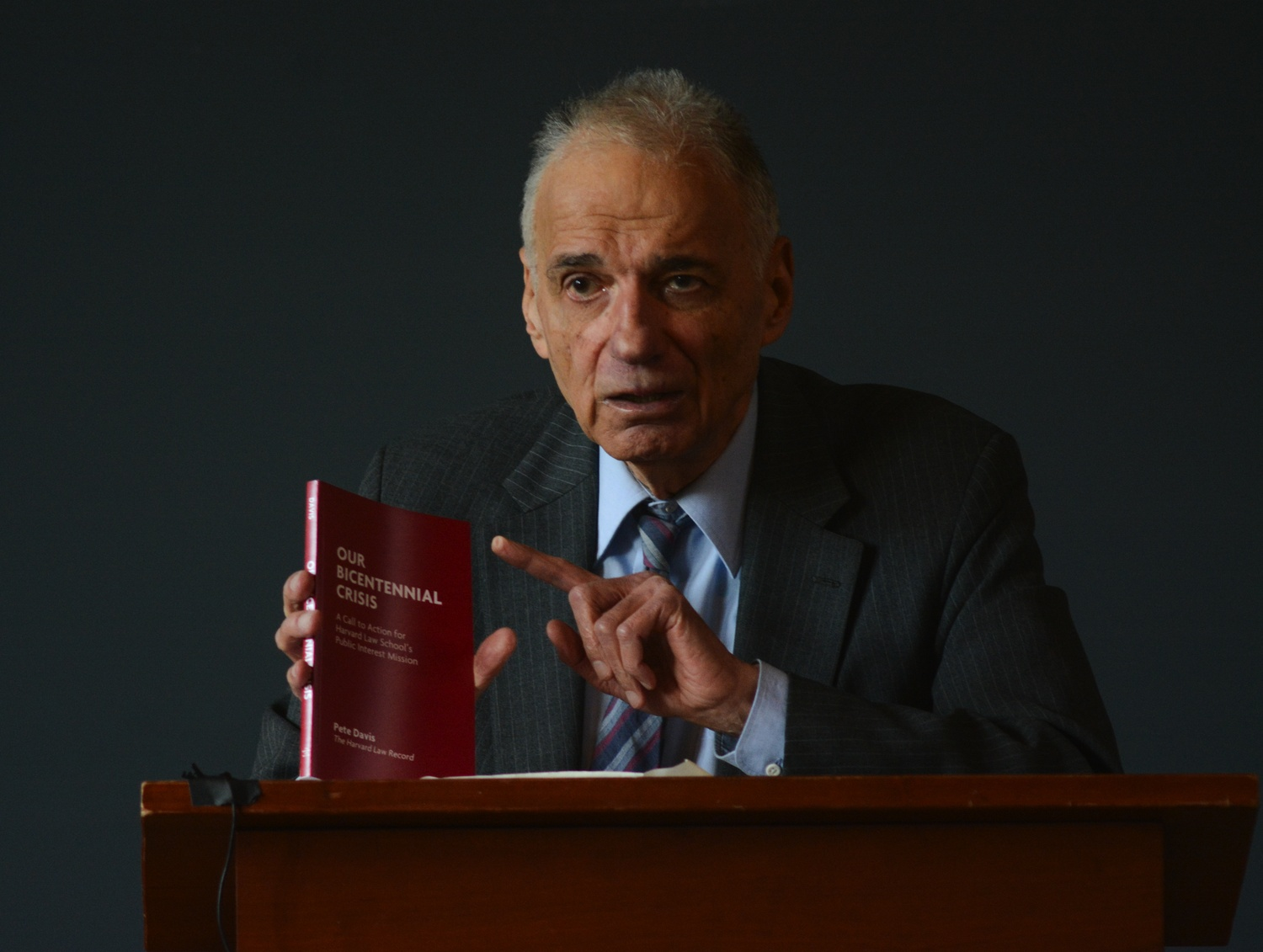 "Repeat presidential candidate Ralph Nader discusses ""Our Bicentennial Crisis,"" a recent publication by Law student Pete Davis. Nader was critical of the school's practices during his talk in Langdell Hall in November."