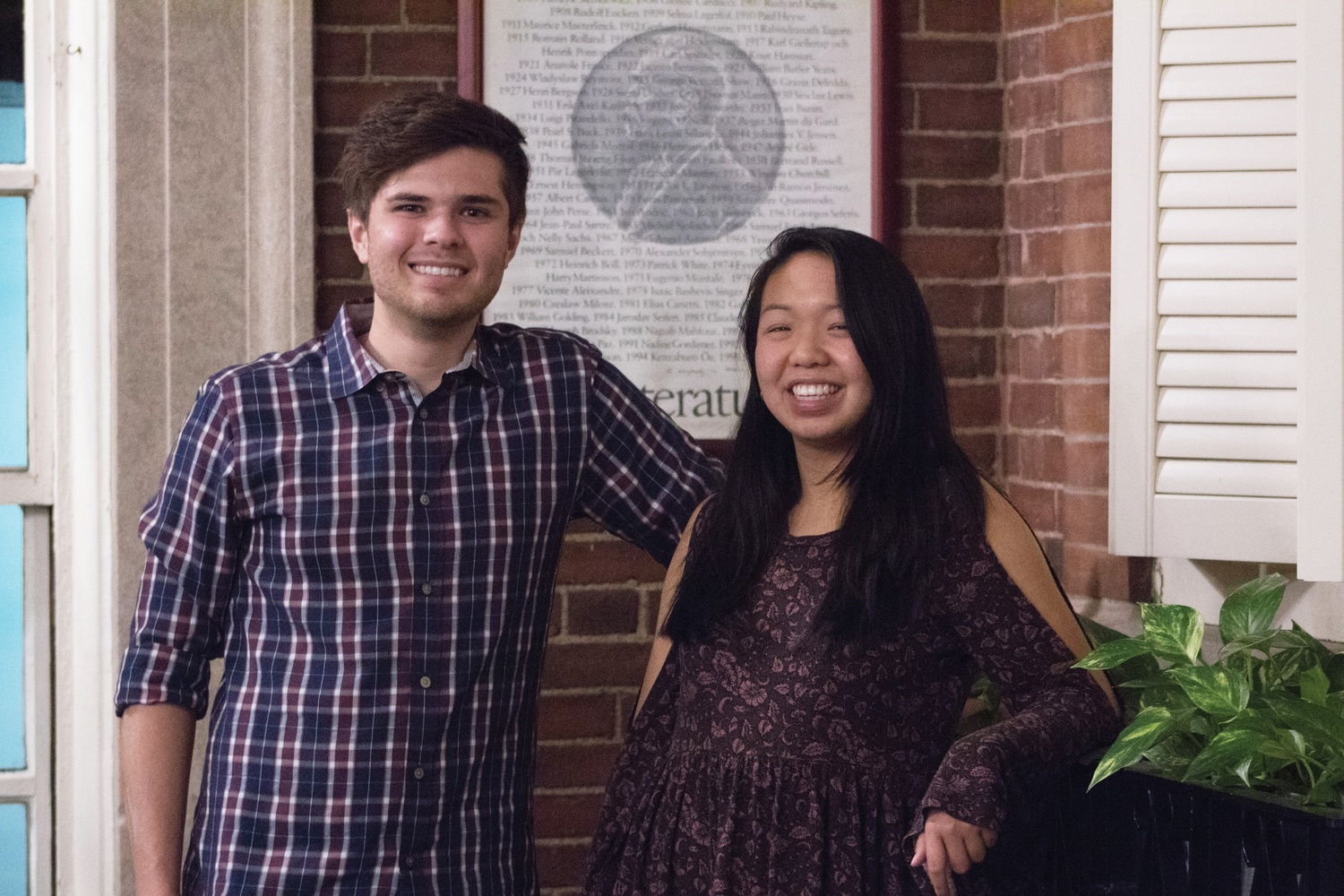 Catherine L. Zhang '19, right, and Nicholas D. Boucher '19, left, pose for a photo Thursday evening in Adams House Conservatory. Zhang and Boucher are running for president and vice president, respectively, of the Undergraduate Council.
