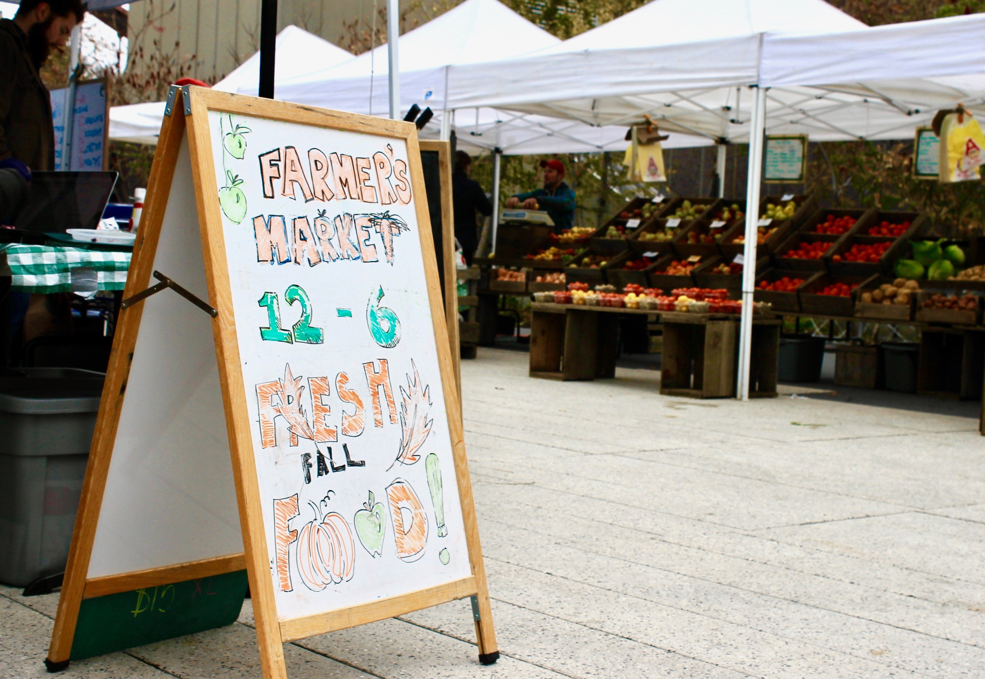Local vendors sell food at the weekly Farmers' Market in the Science Center Plaza on Tuesday.