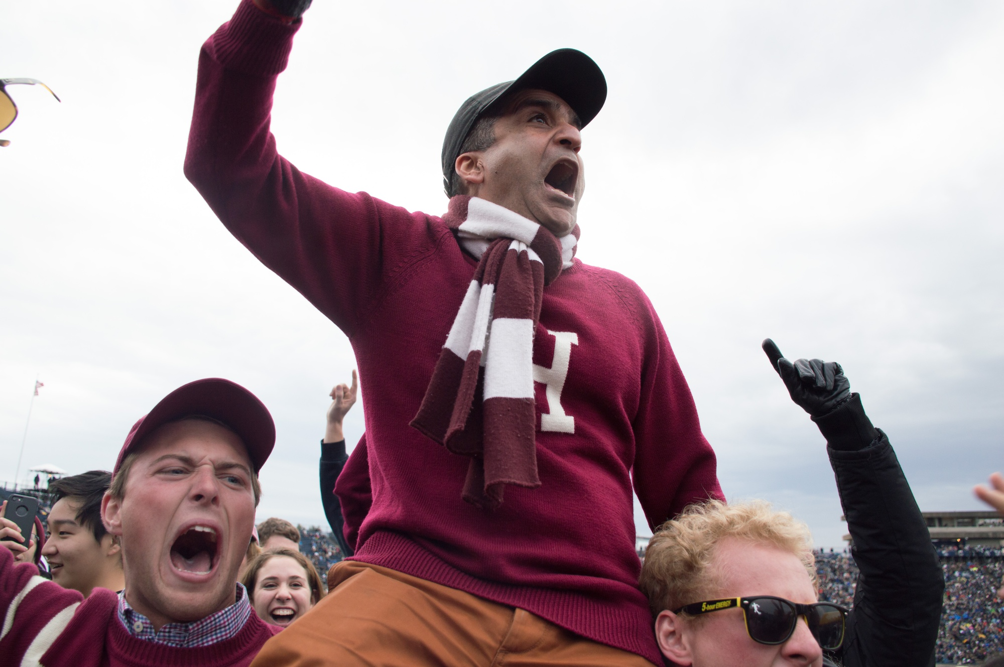 Anthony J. W. Kenny '20 and Sebastian A. Schwartz '20 carry Dean of the College Rakesh Khurana on their shoulders through the stands of the Yale Bowl.