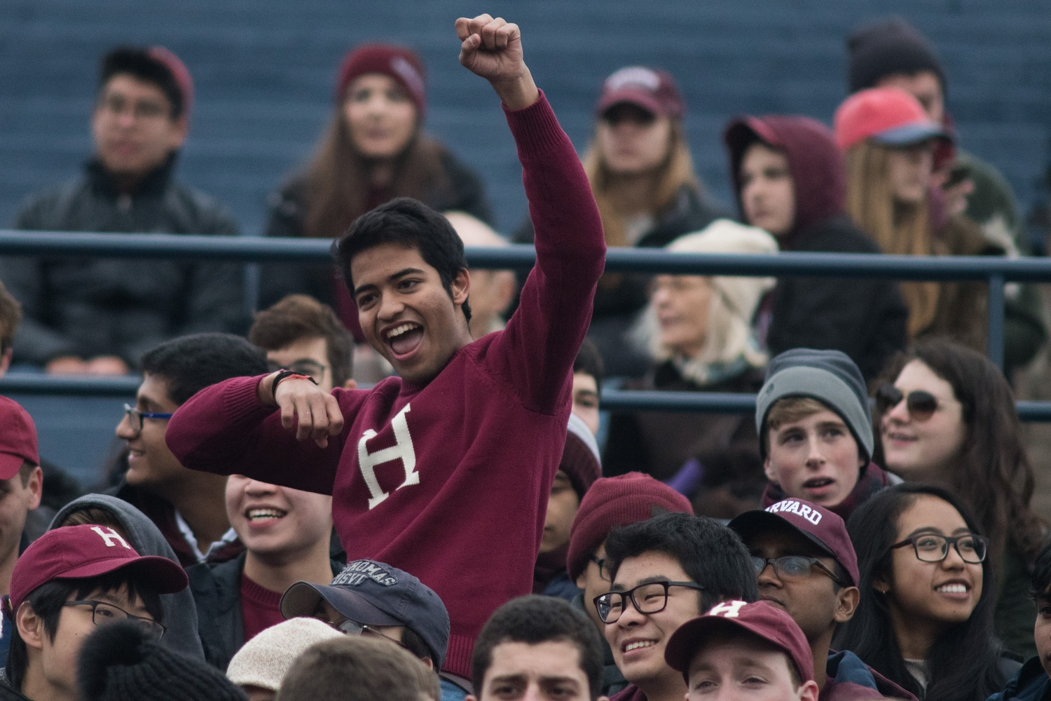 Ajay V. Singh '21 cheers enthusiastically for Harvard early on during the Game.