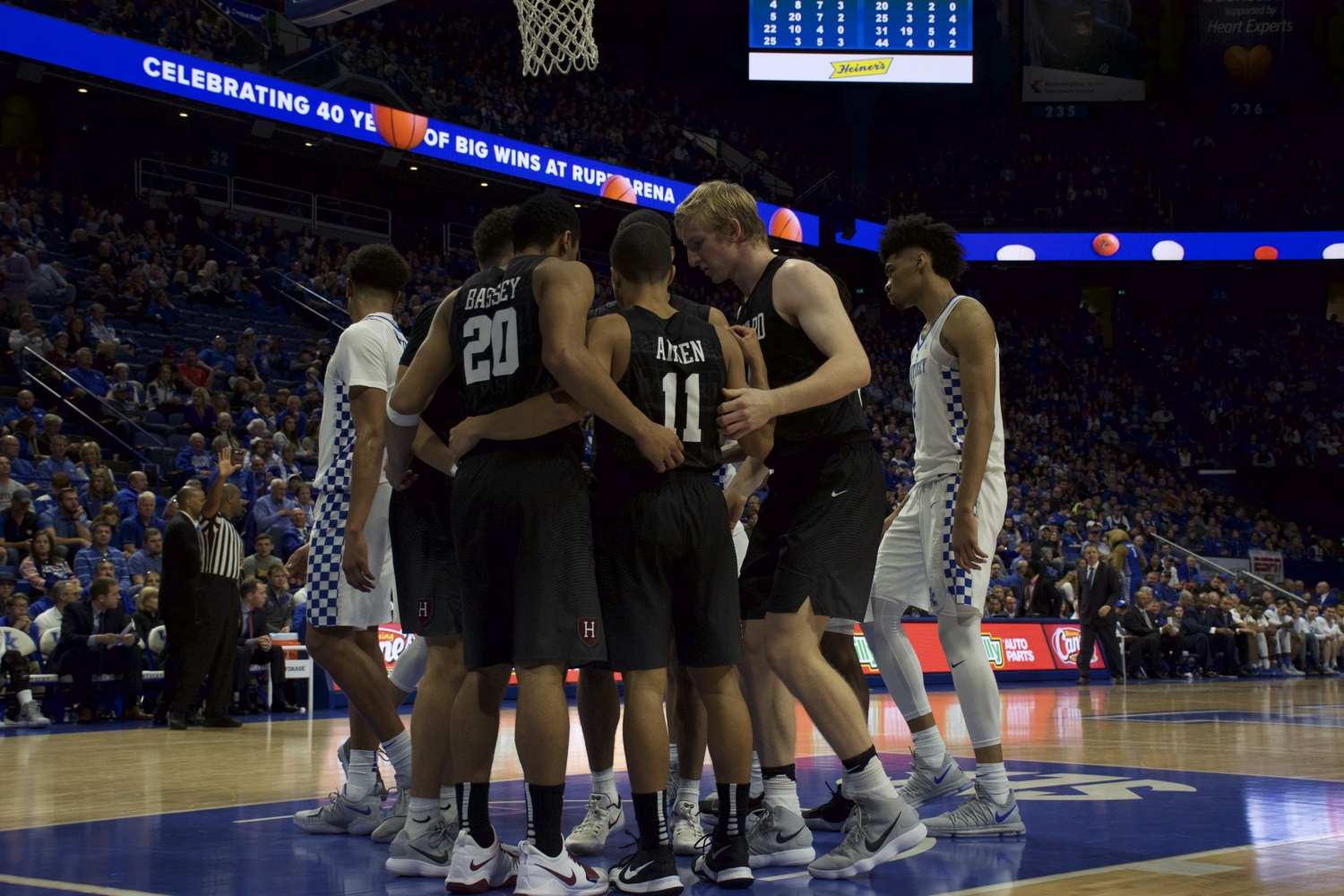 Harvard huddles during a stoppage in play against Kentucky.