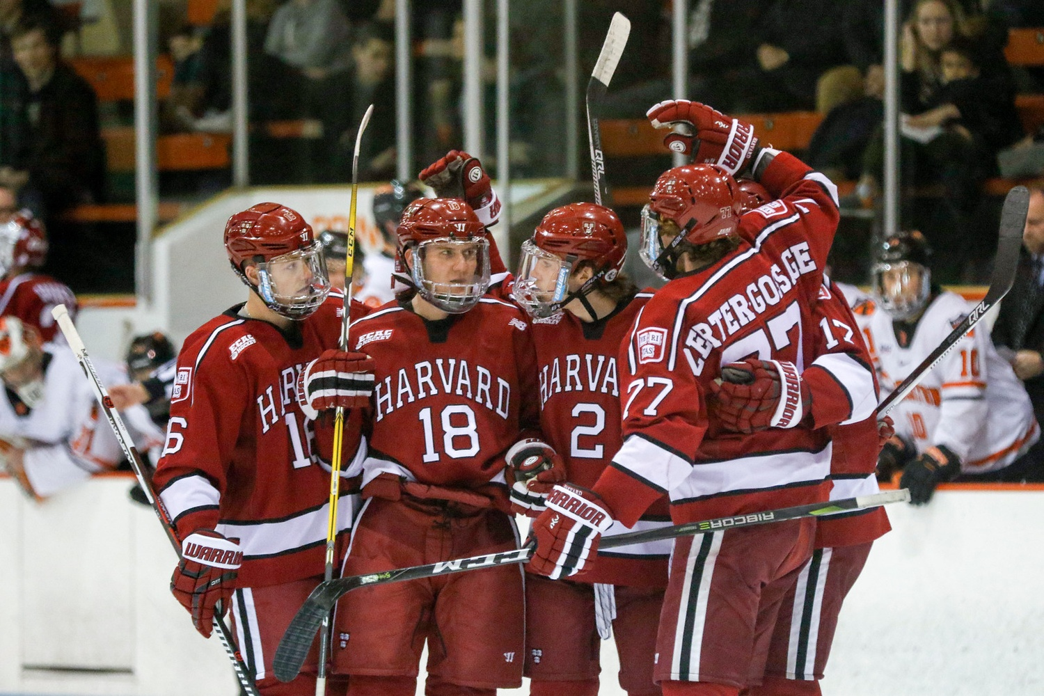 The top power play unit celebrates after freshman Reilly Walsh's one-time snipe from the right circle. Walsh kicked off the scoring for his team, who executed again on the man advantage later in the period.