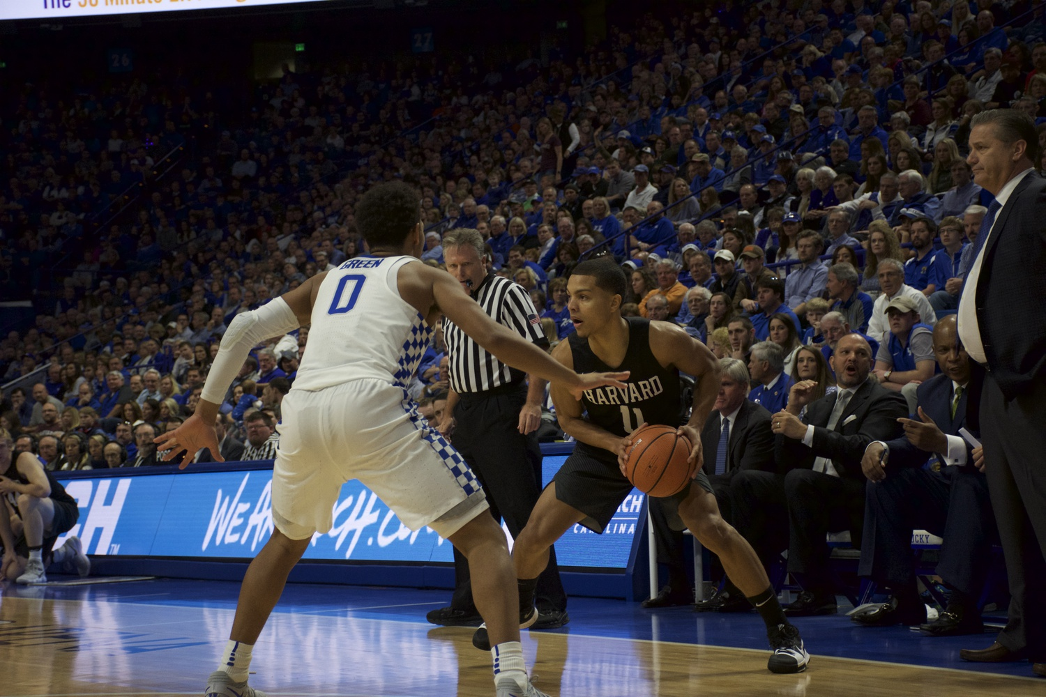 Sophomore guard Bryce Aiken looks to make a pass to a teammate during Harvard's loss against Kentucky last Saturday.