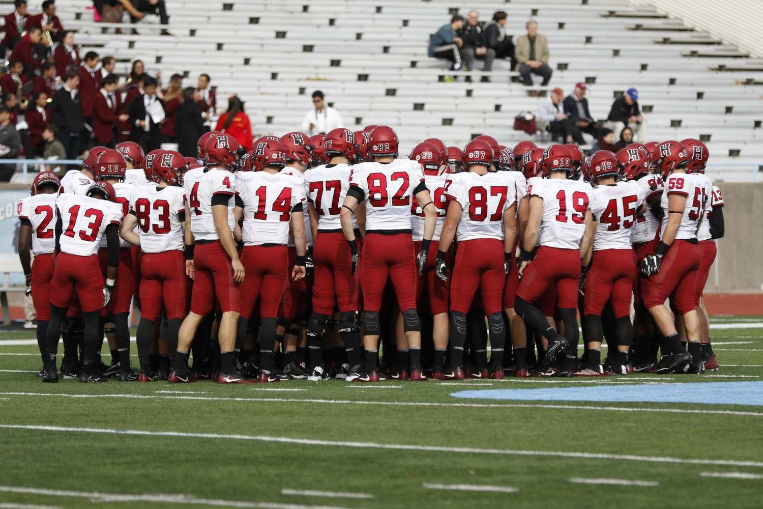 The Crimson huddles up at Columbia earlier this season.