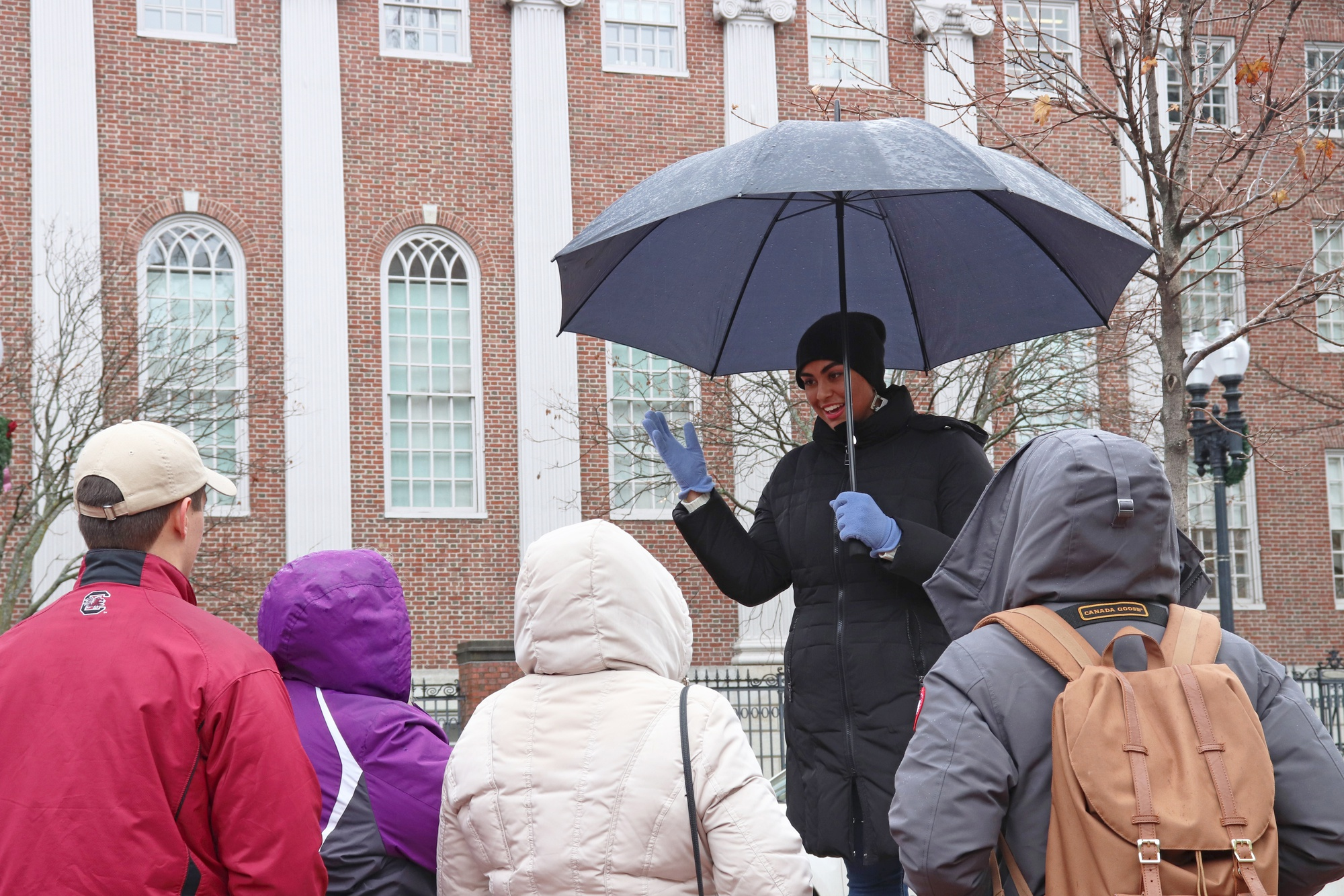 Sufia Mehmood '18 gives a tour of Harvard Yard on Tuesday afternoon.