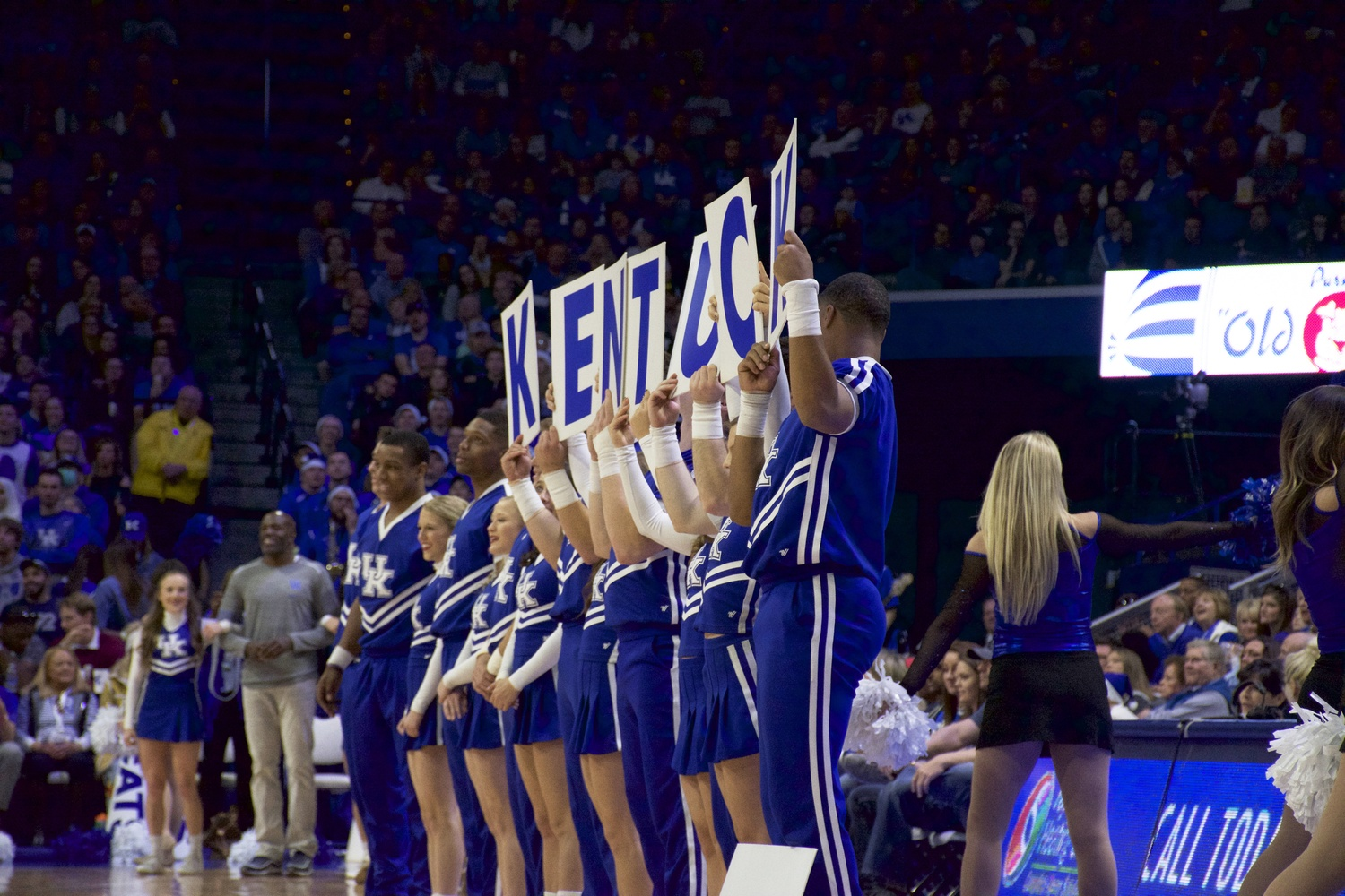 Emerging every timeout, the polished Kentucky cheer squad kept Rupp Arena's nearly 23,000 attendants loud during the Harvard match.