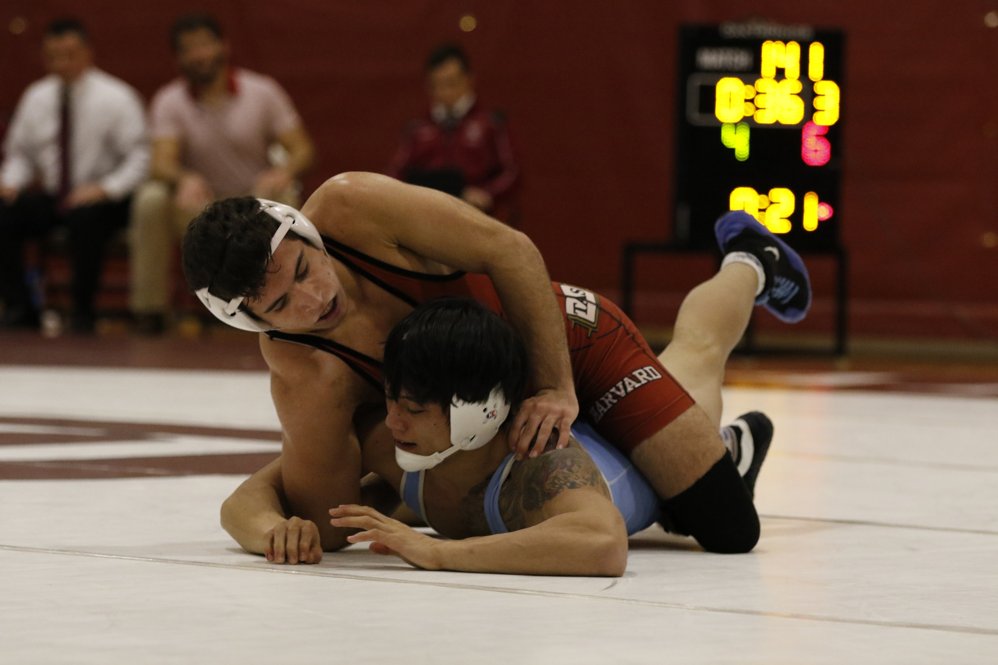 Harvard wrestling (pictured in earlier competition against Columbia) went undefeated on its first weekend of dual meets.