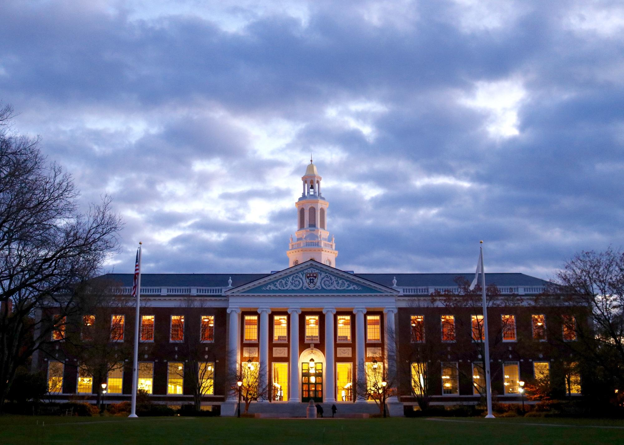 Harvard Business School's Baker Library at dusk.