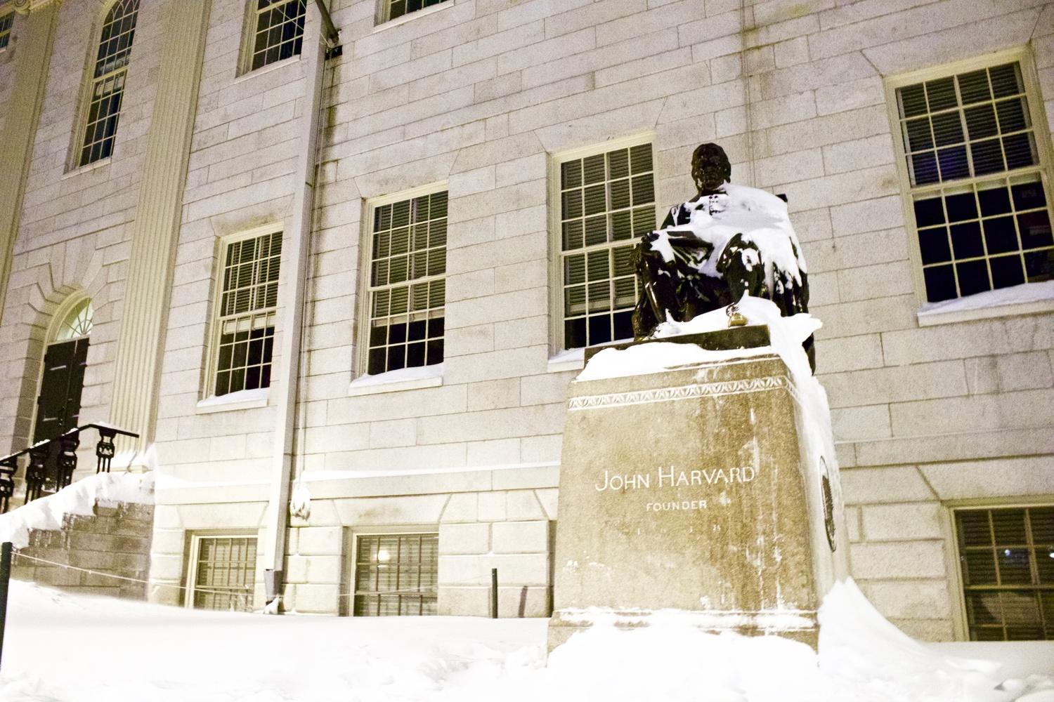 The statue of John Harvard sits, covered by snow, during the 'bomb cyclone' on Jan. 4.